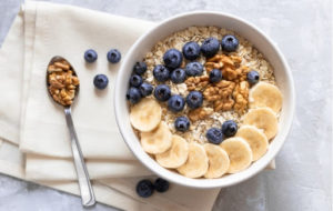 A healthy bowl of oatmeal with fruit, perfect for breakfast